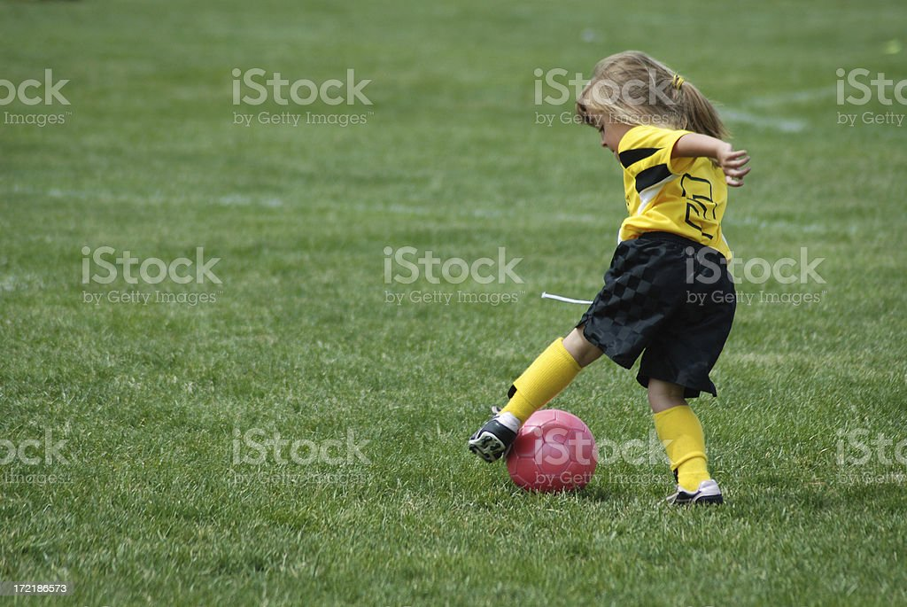 Turning the Soccer Ball royalty-free stock photo