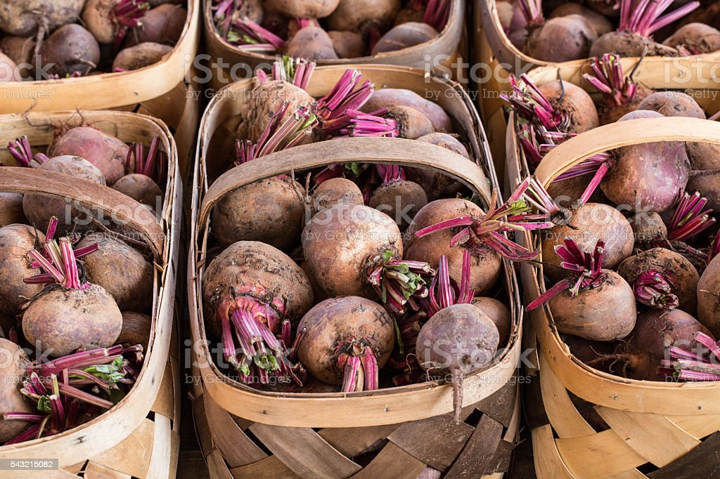 Turnips in Baskets at Farmers Market stock photo