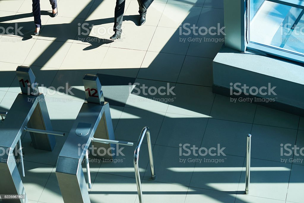 Turnstiles in office lobby stock photo