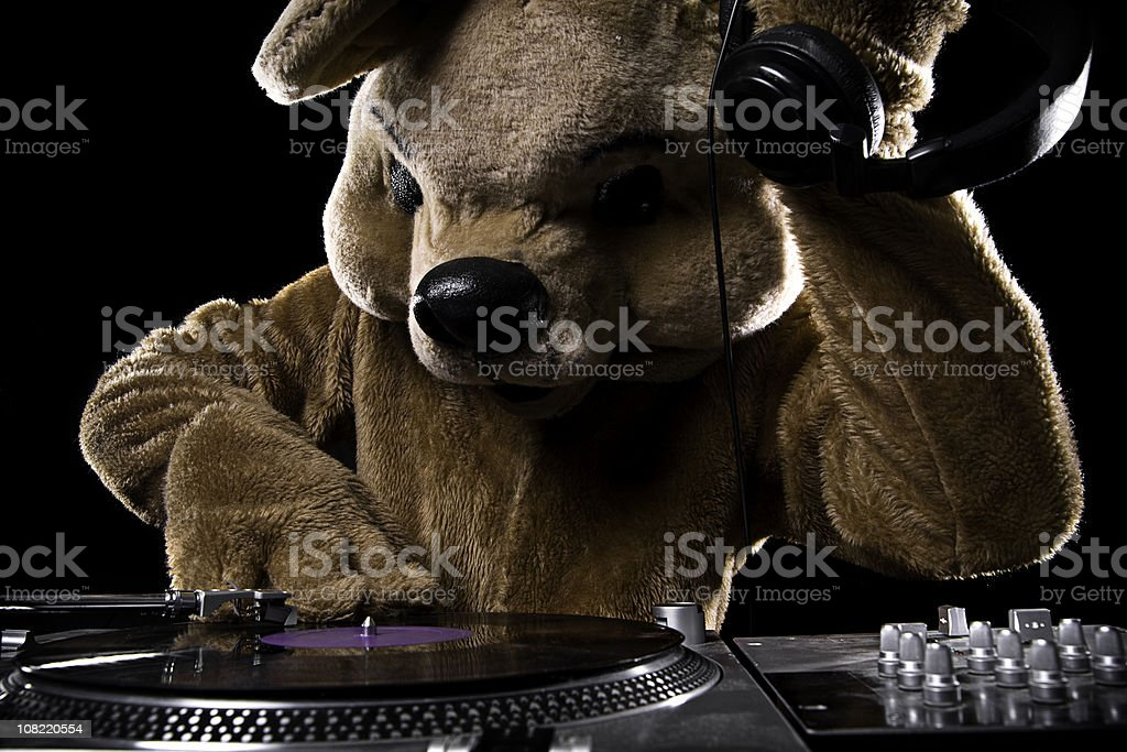 Turntable Bear Costume DJ with Headphones stock photo