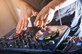 DJ turntable console mixer controlling
