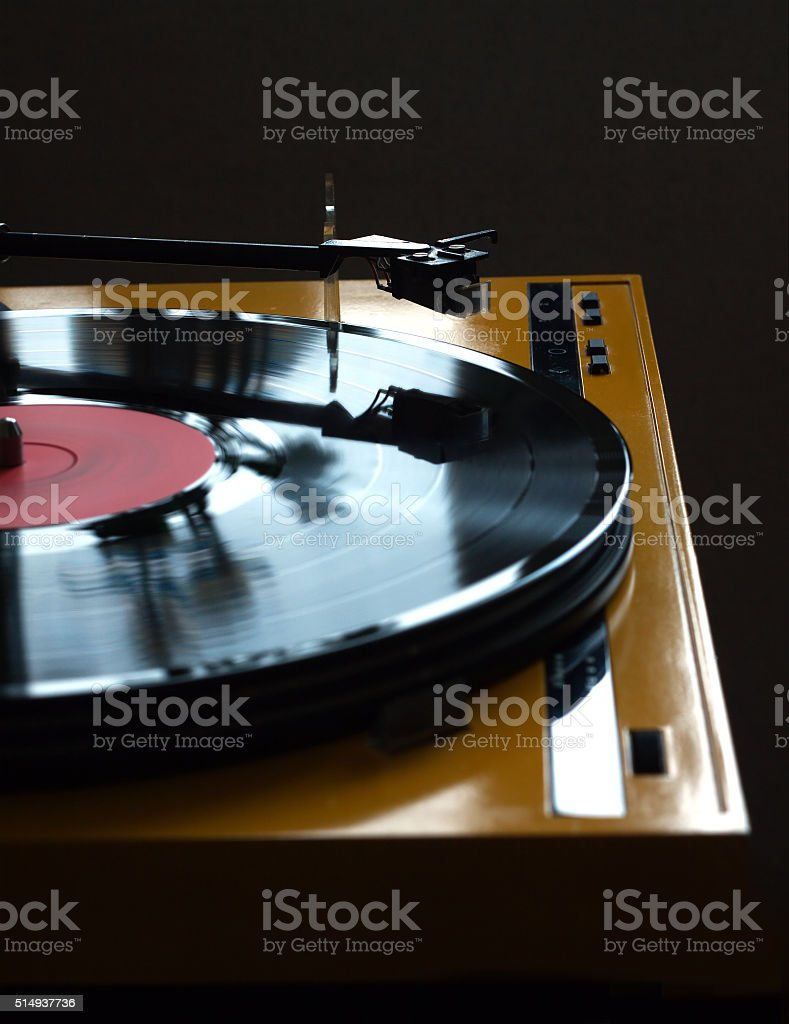 Turntable in yellow case side view isolated stock photo