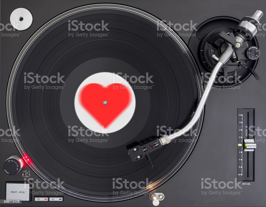 Turntable Play Romantic Melody Record, Shape of Heart Label stock photo