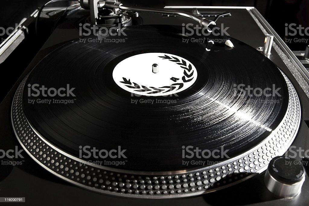 Turntable playing vinyl audio record stock photo