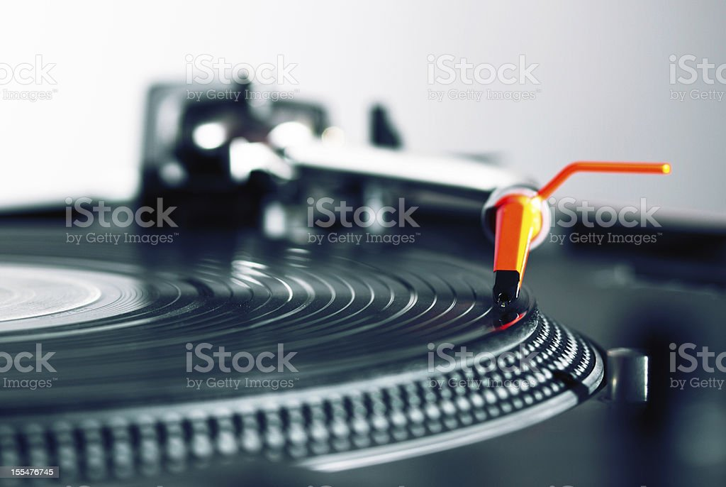 Turntable playing vinyl record royalty-free stock photo