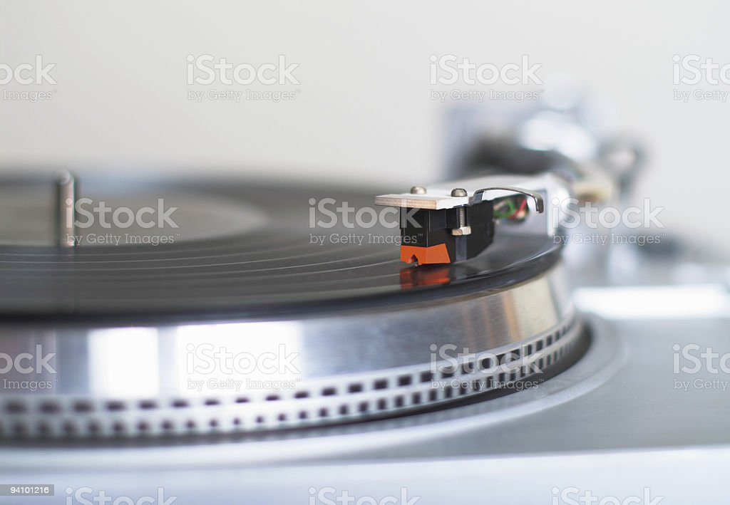 Turntable playing vinyl record stock photo