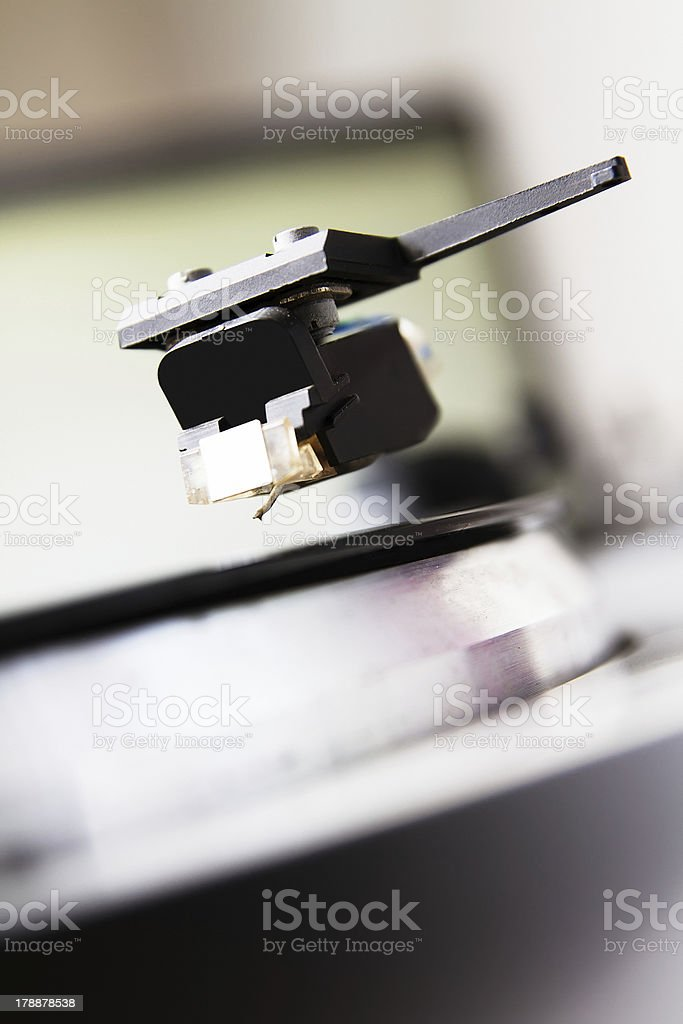 Turntable playing vinyl record with music royalty-free stock photo