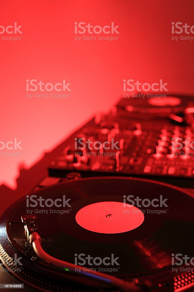 DJ turntable with mixer and vinyl record stock photo