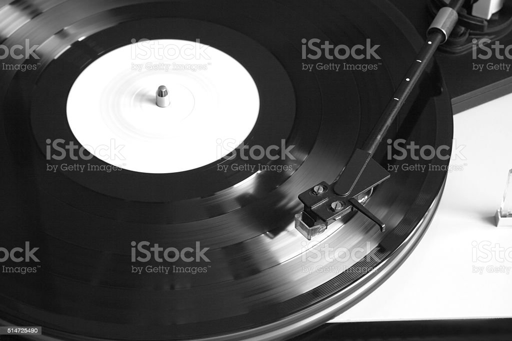 Turntable with playing vinyl record closeup stock photo