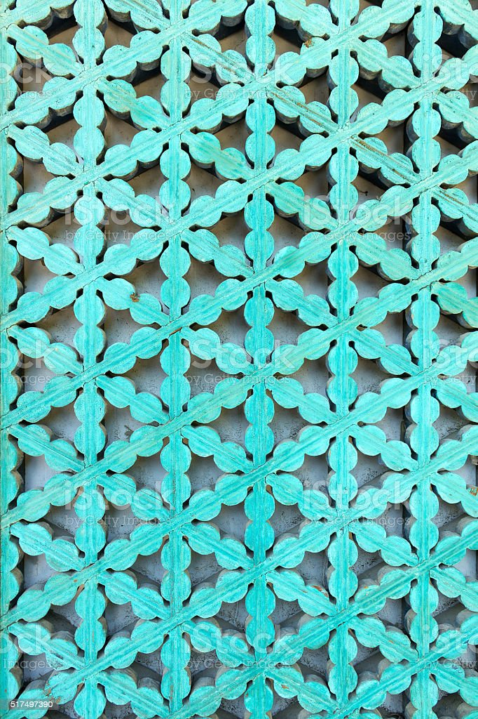 Turquois shutter ornament stock photo