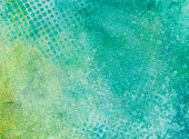 Turquoise and chartreuse mottled background with dotted pattern
