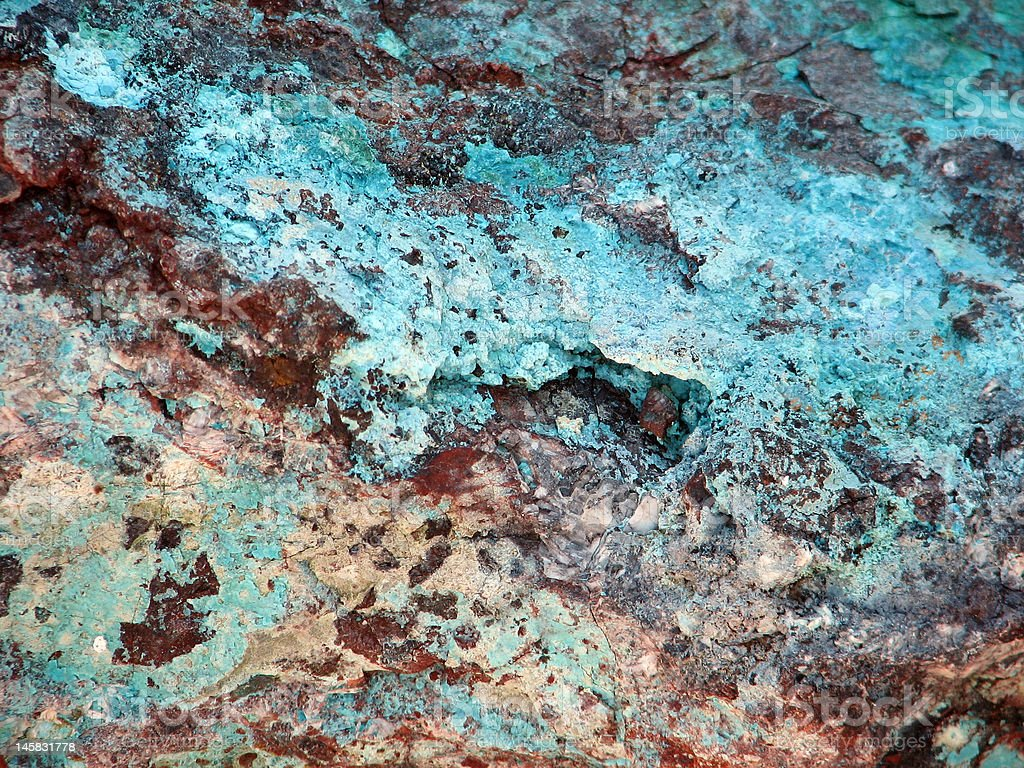 Turquoise and copper rock stock photo