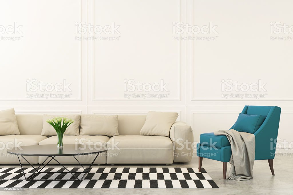 Turquoise armchair and sofa in the living room stock photo