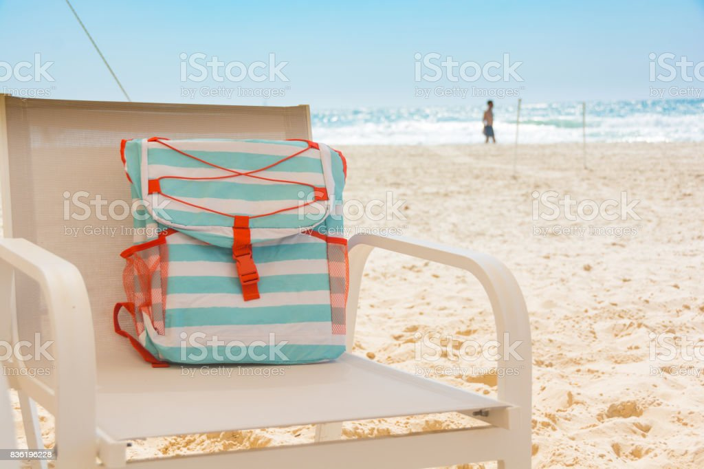 Turquoise Beach Bag on mesh chair stock photo
