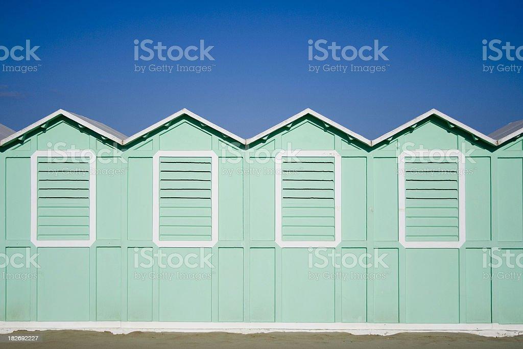 Turquoise beach cabanas stock photo