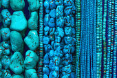 Turquoise Beads and Necklaces Hanging in Shop (Close-Up)