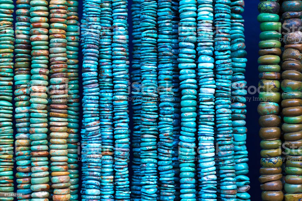 Turquoise Beads and Necklaces Hanging (Close-Up) stock photo