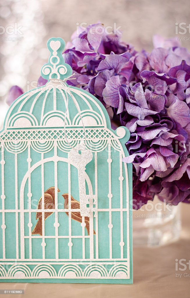 Turquoise Cage with Purple Hydrangeas stock photo