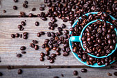 Turquoise cup with coffee beans