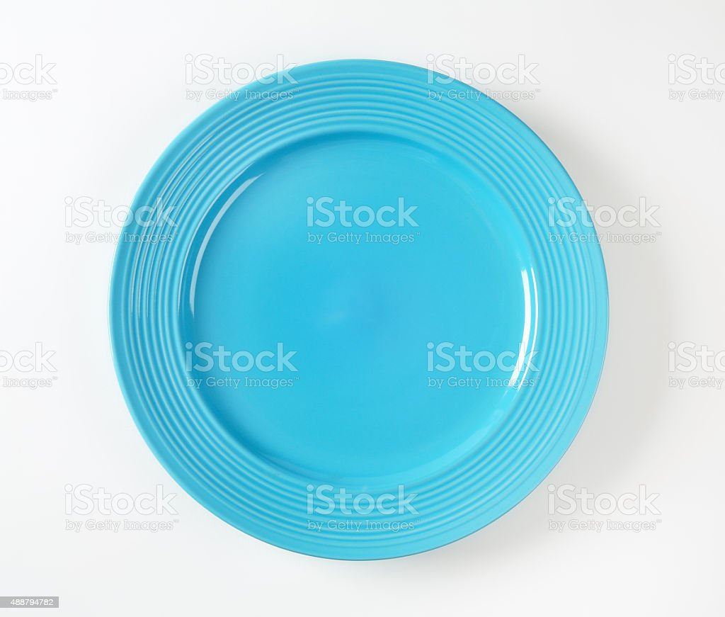 Turquoise dinner plate with wide rim stock photo