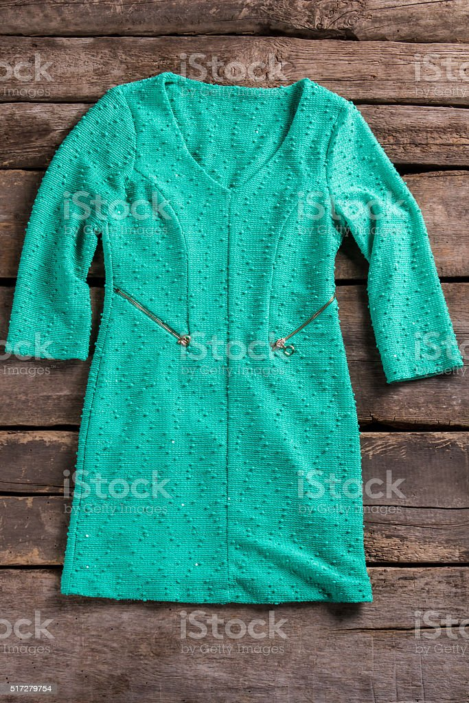 Turquoise dress with zipper pockets. stock photo