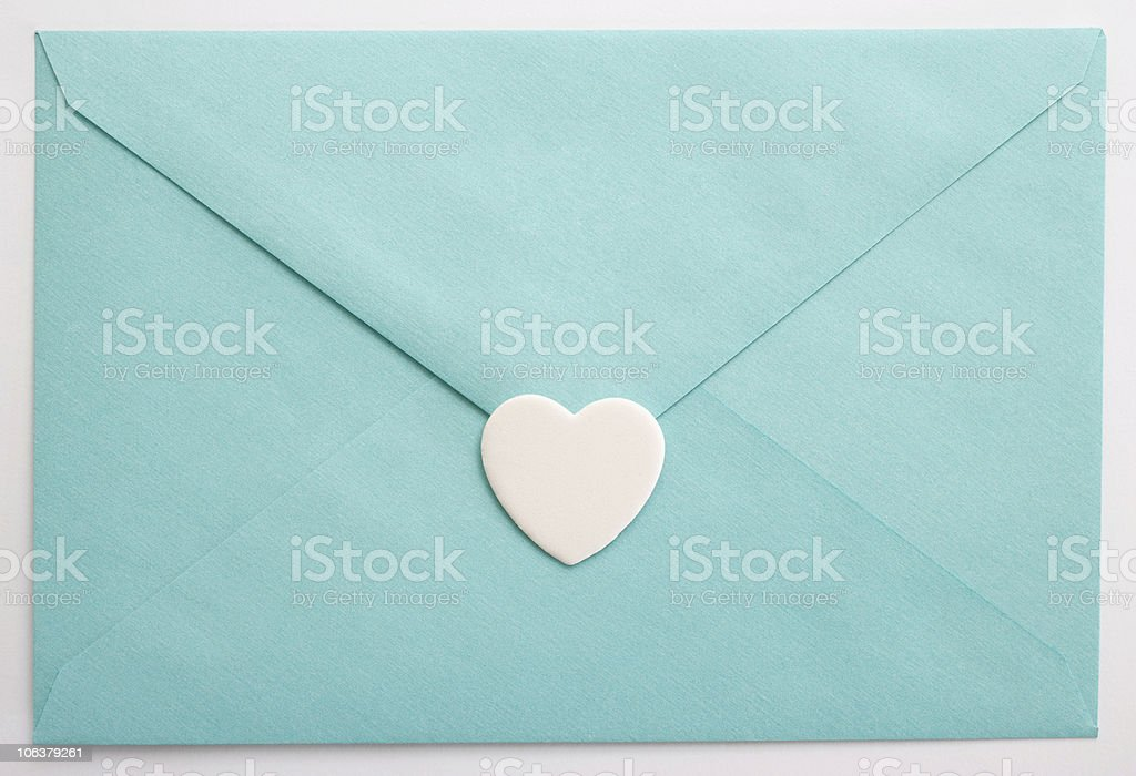 Turquoise envelope and heart royalty-free stock photo