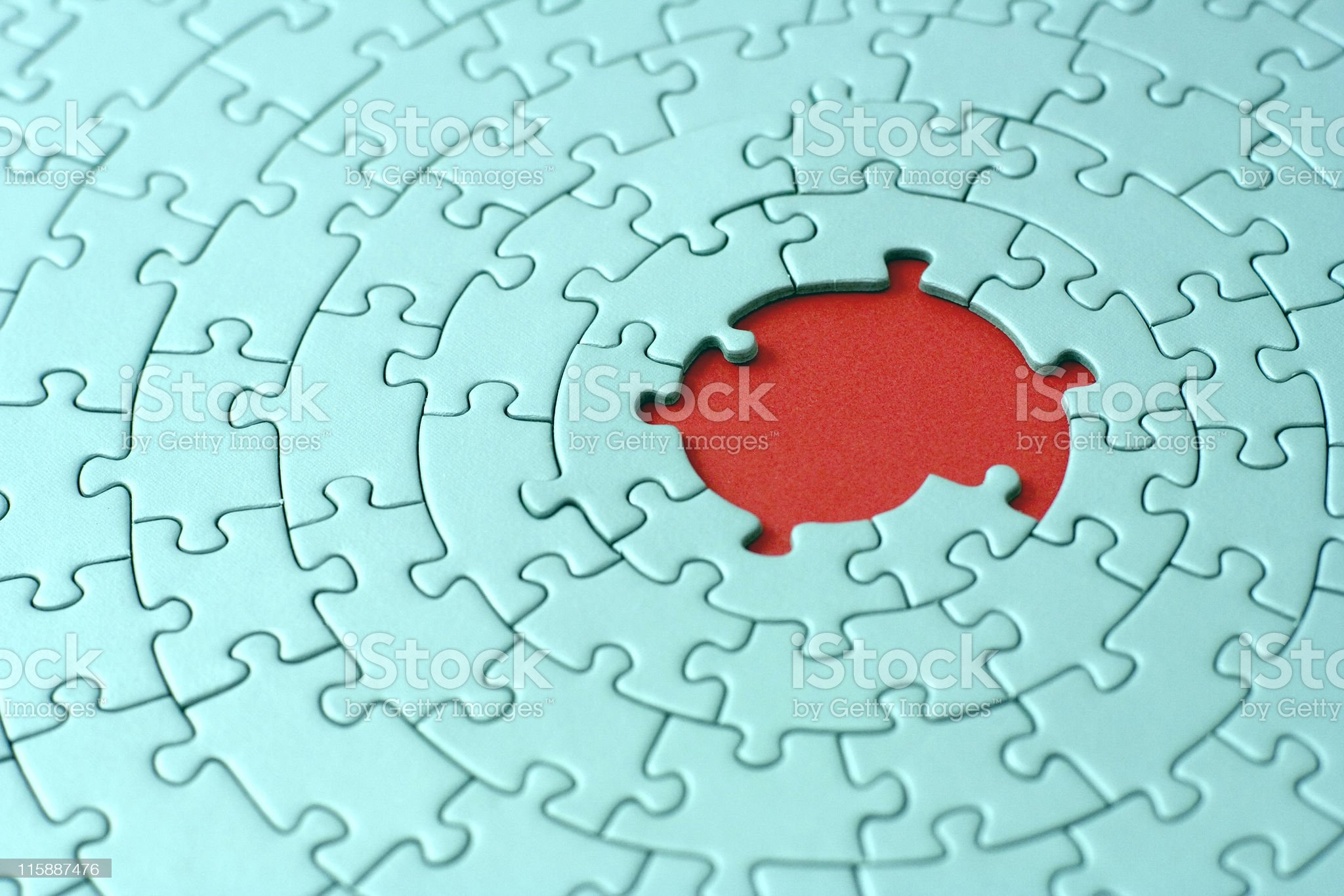 turquoise jigsaw with missing pieces in the red center royalty-free stock photo