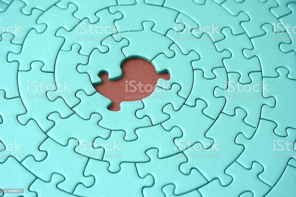 turquoise jigsaw with one missing piece royalty-free stock photo