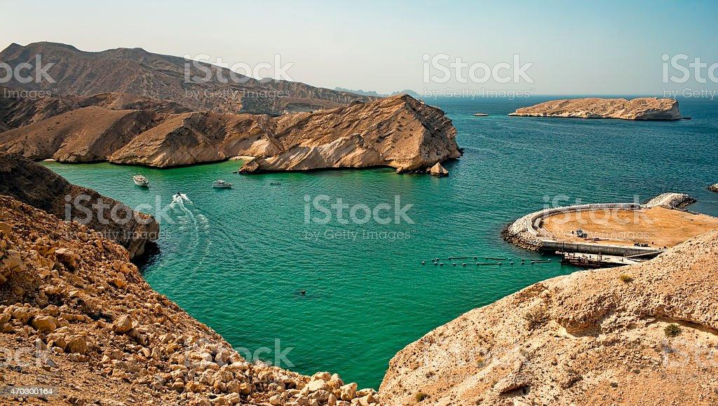 Turquoise Lagoon Oman Coast with hidden beautiful beach stock photo