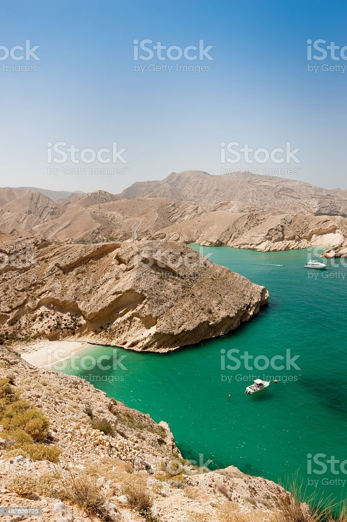 Turquoise Lagoon Oman Coast with hidden beautiful beach royalty-free stock photo