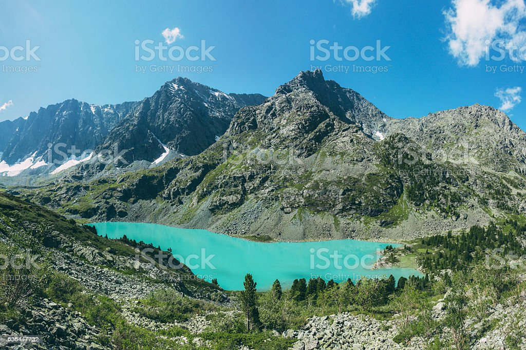 Turquoise lake in valley of rocky slope, Kuyguk, Altai, Russia stock photo