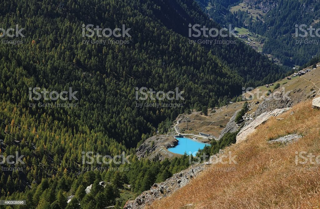 Turquoise lake Mosjesee and colorful larch forest stock photo