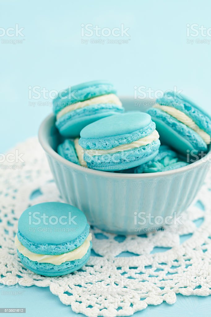 Turquoise macarons with buttercream filling stock photo