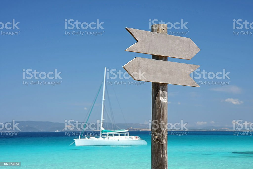 turquoise mediterranean sea with sign and yacht stock photo