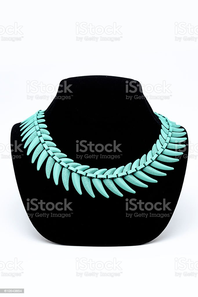turquoise necklace on a mannequin stock photo