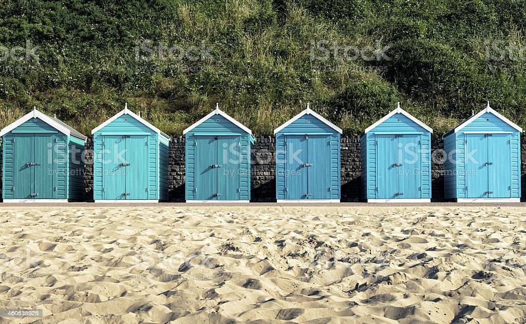 Turquoise painted wooden beach huts in Bournemouth stock photo
