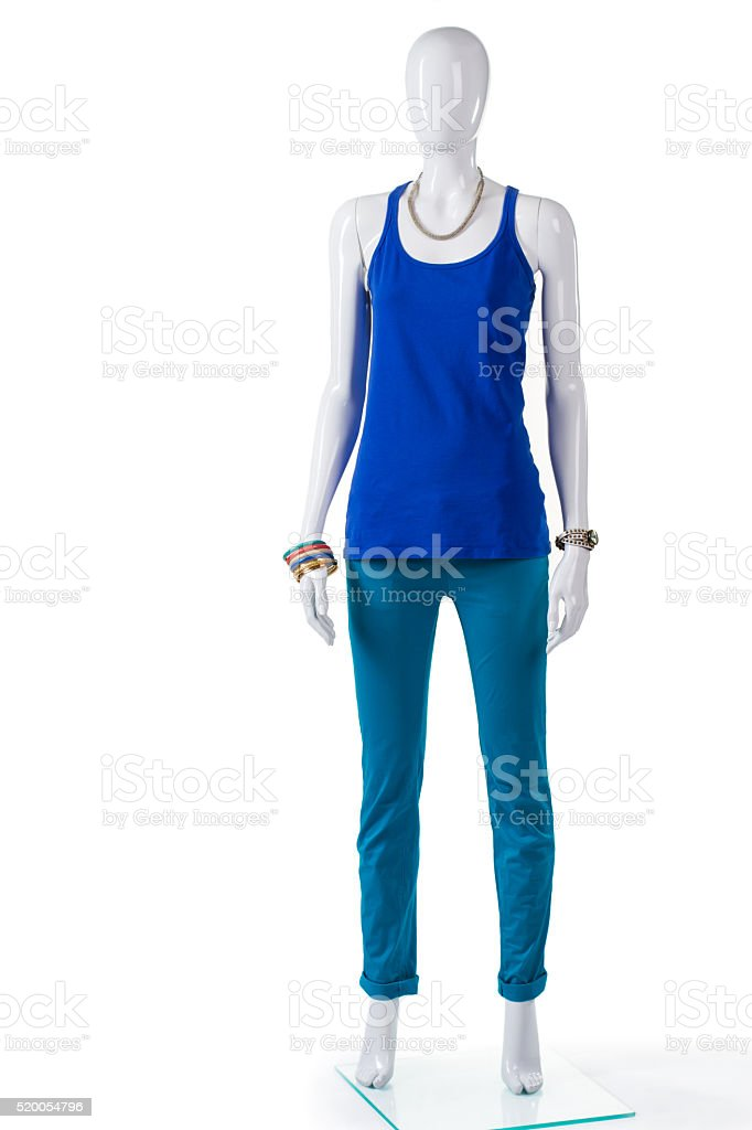 Turquoise pants with blue top. stock photo