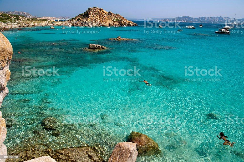 Turquoise sea and boats at La Maddalena stock photo