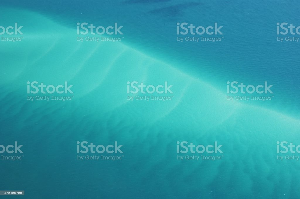 Turquoise Sea and white sand vector art illustration