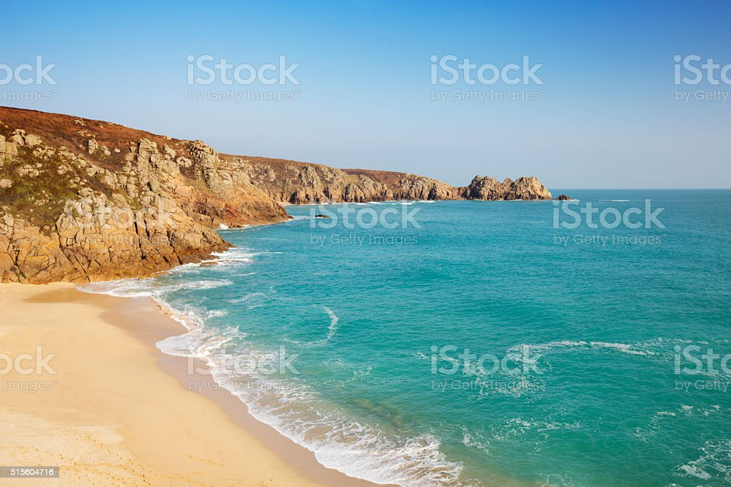 Turquoise sea at Porthcurno Beach in Cornwall, South England stock photo