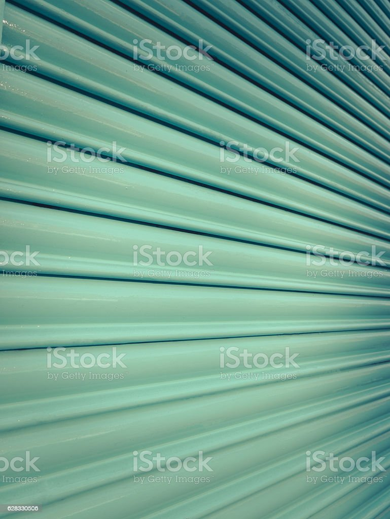 Turquoise Store Window Shutter stock photo