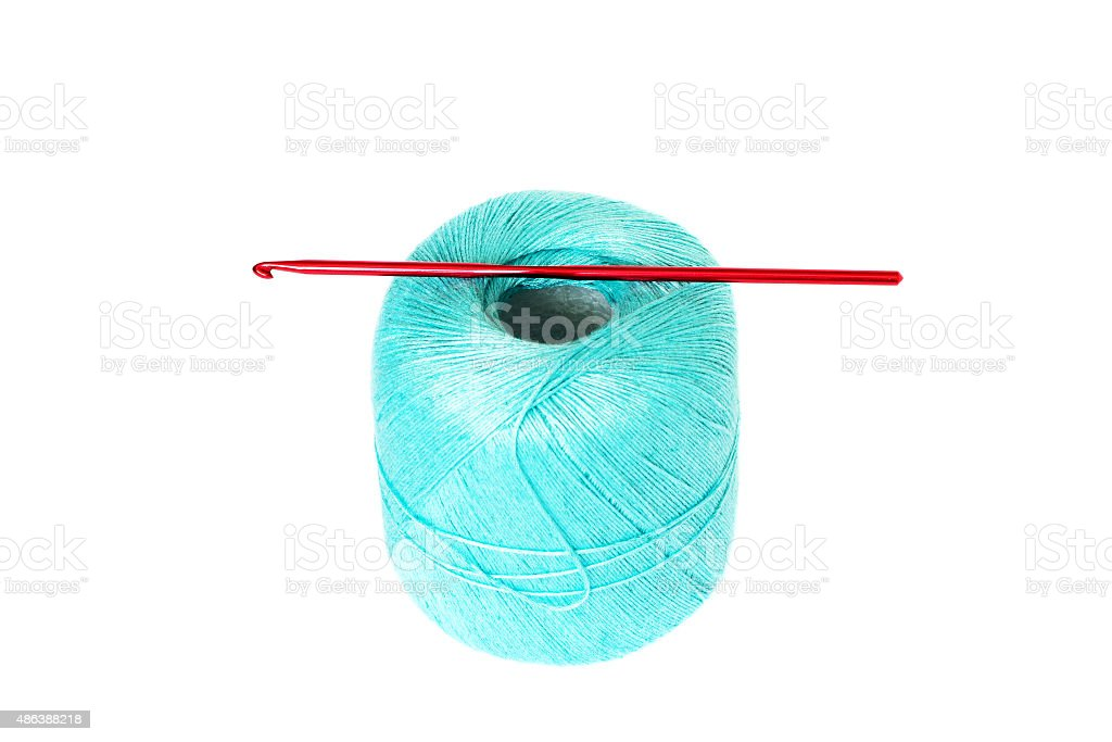 Turquoise thread clew with crochet hook isolated on white backgr stock photo