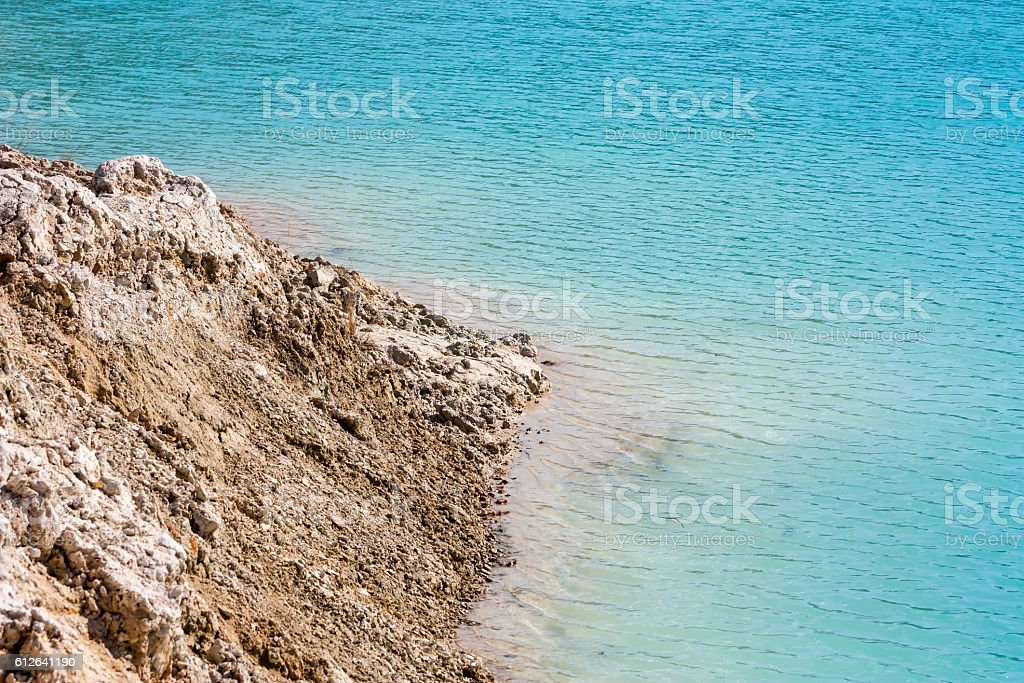 Turquoise water in a flooded clay quarry royalty-free stock photo