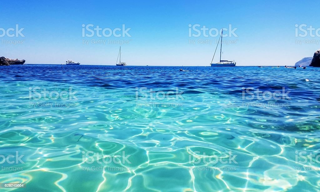 Turquoise waters and boats on a beach in Majorca stock photo