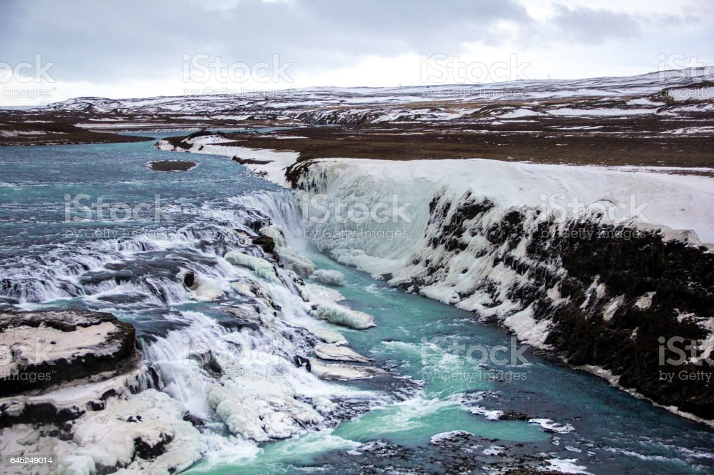 Turquoise waters of the Gulfoss waterfall during winter day stock photo
