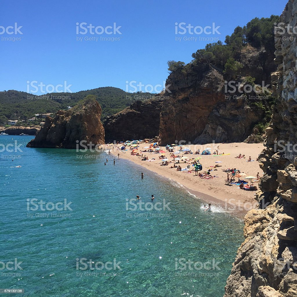 Turquoise waters on a Mediterranean beach in Costa Brava, Catalonia. stock photo