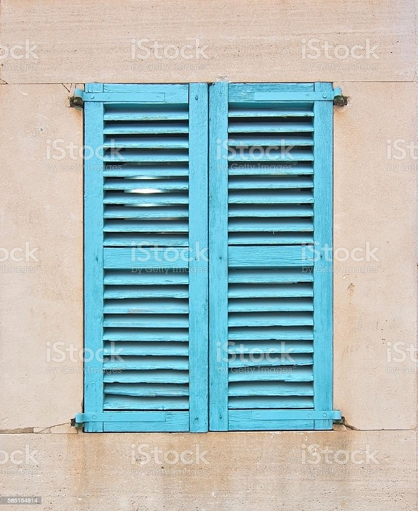 Turquoise window with shutters stock photo