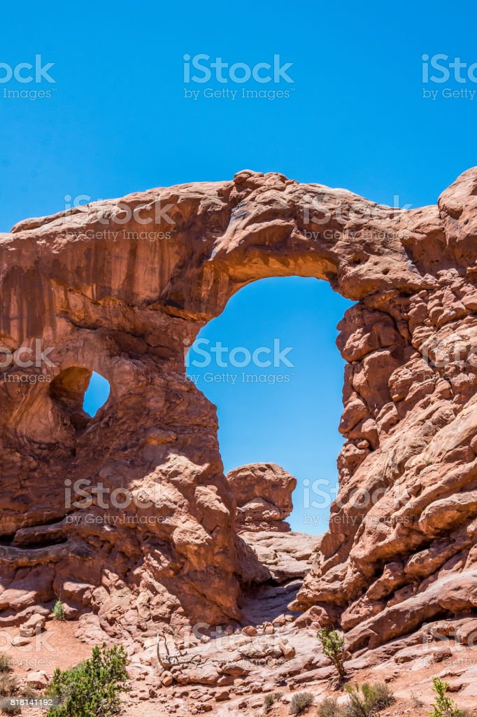 Turret Arch. Scenic cliffs of Arches National Park at sunset stock photo