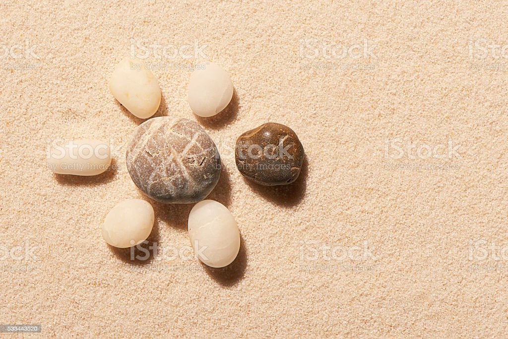 Turtle made of sea stones on sand. Summer beach background stock photo