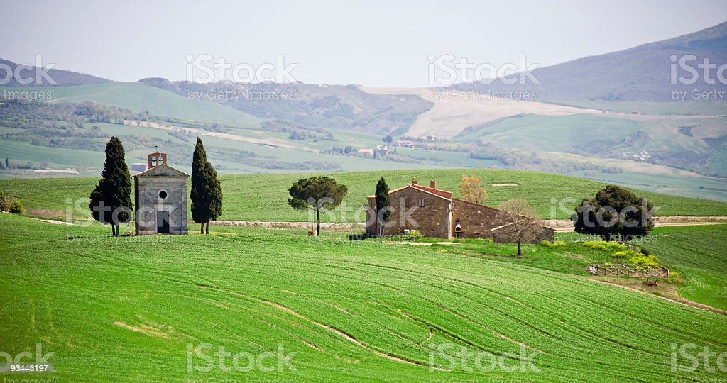 Tuscan farmhouse and small church royalty-free stock photo
